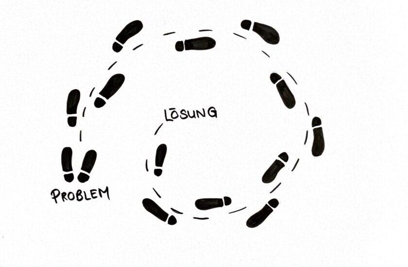 Skizzierte Fussabdrücke als Symbol für die Problemlösung in 12 Schritten